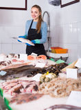 Girl posing near display with fish Stock Photos