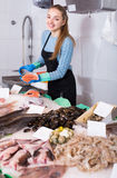 Girl posing near display with fish Royalty Free Stock Photo