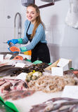 Girl posing near display with fish Stock Image