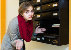 Girl posing near empty mailbox Stock Photography