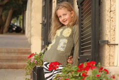 Girl posing near flowers Royalty Free Stock Photos