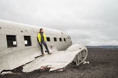 Girl posing near remainings of crashed airplane Royalty Free Stock Images