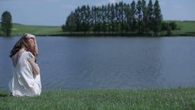 Girl  posing near river stock video
