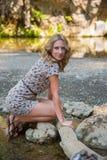 Girl Posing Near Small Lake Royalty Free Stock Photos