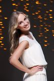 Girl posing during new year party celebration. Beautiful blonde at new year party celebration Royalty Free Stock Images