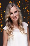 Girl posing during new year party celebration. Beautiful blonde at new year party celebration Stock Photography