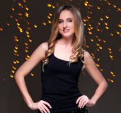 Girl posing during new year party celebration. Beautiful blonde at new year party celebration Royalty Free Stock Photography
