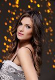 Girl posing during new year party celebration. Beautiful brunette at new year party celebration Royalty Free Stock Photography