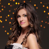 Girl posing during new year party celebration. Beautiful brunette at new year party celebration Stock Photo