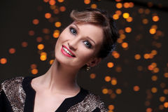 Girl posing during new year party celebration. Beautiful woman at new year party celebration Stock Photo