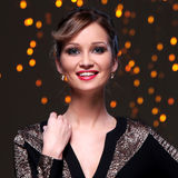 Girl posing during new year party celebration. Beautiful woman at new year party celebration Stock Images