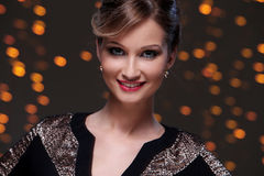 Girl posing during new year party celebration. Beautiful woman at new year party celebration Royalty Free Stock Photography