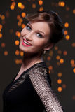 Girl posing during new year party celebration. Beautiful woman at new year party celebration Royalty Free Stock Image