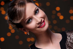 Girl posing during new year party celebration. Beautiful woman at new year party celebration Royalty Free Stock Images