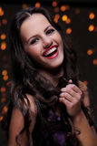 Girl posing during new year party celebration. Cute brunette have beautiful, wide smile Stock Images