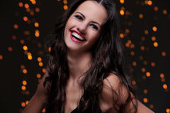 Girl posing during new year party celebration. Cute brunette have beautiful, wide smile Royalty Free Stock Photo