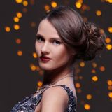 Girl posing during new year party celebration. Woman with beautiful hairstyle at new year party celebration Royalty Free Stock Photography