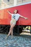 Girl Posing by Old Tram Stock Images