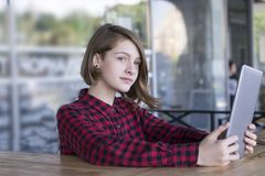 Girl posing outdoors using tablet pc stock image