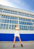 Girl posing over old factory Royalty Free Stock Photography