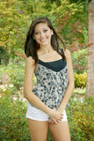 Girl posing in the park. Young beautiful girl outdoor portrait standing Royalty Free Stock Photography