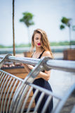 Girl posing in park. Young beauty girl posing on street near the beautiful handrails royalty free stock images