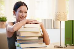 Girl posing with pile of books to learn Stock Photos