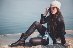 Girl posing on the river bank Stock Image