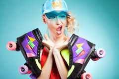 Girl posing with rollers. Royalty Free Stock Photography