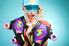 Girl posing with rollers. Royalty Free Stock Image