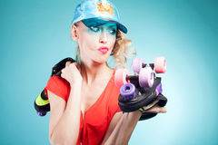 Girl posing with rollers. Royalty Free Stock Images