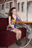 Girl Posing Sitting At Table Stock Image