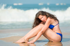 Girl Posing Sitting On The Wet Sand Royalty Free Stock Images