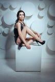 Girl posing sitting. Royalty Free Stock Photo