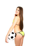 Girl posing with a soccer ball on a white background Stock Images