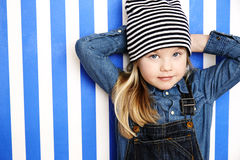 Girl posing in stripy hat Royalty Free Stock Photos