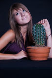Girl posing in studio with cactus Royalty Free Stock Images