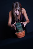 Girl posing in studio with cactus Stock Photo