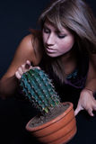 Girl posing in studio with cactus Royalty Free Stock Image