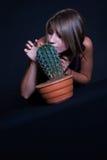 Girl posing in studio with cactus Stock Photo