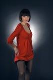 Girl posing in studio on dark background Royalty Free Stock Photos