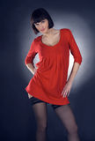 Girl posing in studio on dark background Royalty Free Stock Photo