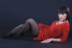 Girl posing in studio on dark background Stock Photography