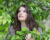 Girl posing surrounded by leaves Royalty Free Stock Images