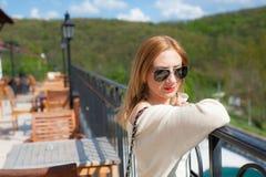 Girl Posing on Terrace Stock Image