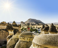 Girl posing on top of a cliff in Cappadocia, Turkey Royalty Free Stock Photography