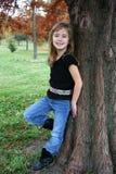 Girl Posing by Tree royalty free stock photo