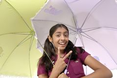Girl posing with two umbrella Stock Image