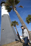 Girl posing by Tybee Island Lighthouse. In Georgia royalty free stock image