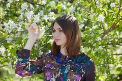 Girl posing under apple-tree Royalty Free Stock Photos